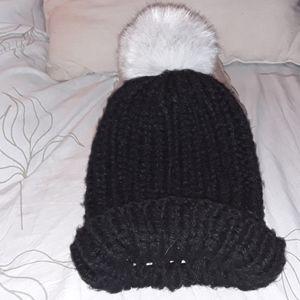 Surell black hat with white faux fur pom pom